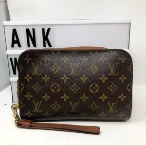 Louis Vuitton Orsay Monogram wristlet clutch bag